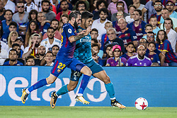 August 13, 2017 - Barcelona, Catalonia, Spain - FC Barcelona midfielder ALEIX VIDAL competes with Real Madrid midfielder ASENSIO for the ball during the Spanish Super Cup Final 1st leg between FC Barcelona and Real Madrid at the Camp Nou stadium in Barcelona (Credit Image: © Matthias Oesterle via ZUMA Wire)