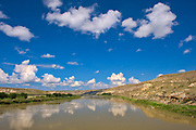 Badlands  and clouds reflected in the South Saskatchewan River off Hwy 41<br />Near Empress<br />Alberta<br />Canada