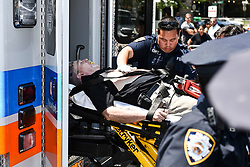 A man most likely had a heart attack during Trump supporting demonstration in Foley Sq in Manhattan, being taken away to an Ambulance by EMS. Saturday June 10, 2017<br /> <br /> <br /> 6/10/2017<br /> Manhattan, NY<br /> <br /> Go Nakamura/ZUMA Press