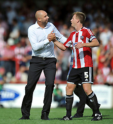 Charlton Athletic Manager, Bob Peeters has a chat with Brentford's Tony Craig after the match - Photo mandatory by-line: Patrick Khachfe/JMP - Mobile: 07966 386802 09/08/2014 - SPORT - FOOTBALL - Brentford - Griffin Park - Brentford v Charlton Athletic - Sky Bet Championship - First game of the season