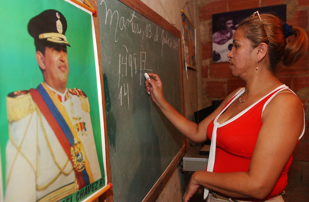 Yubeney Castillo, 20, teaches a Mision Robinson literacy class in a private home in Campo Rico, a poor hillside shanty town in eastern Caracas on Tuesday August 3, 2004.  The literacy classes are one of numerous social programs that have come about during the Chavez presidency.