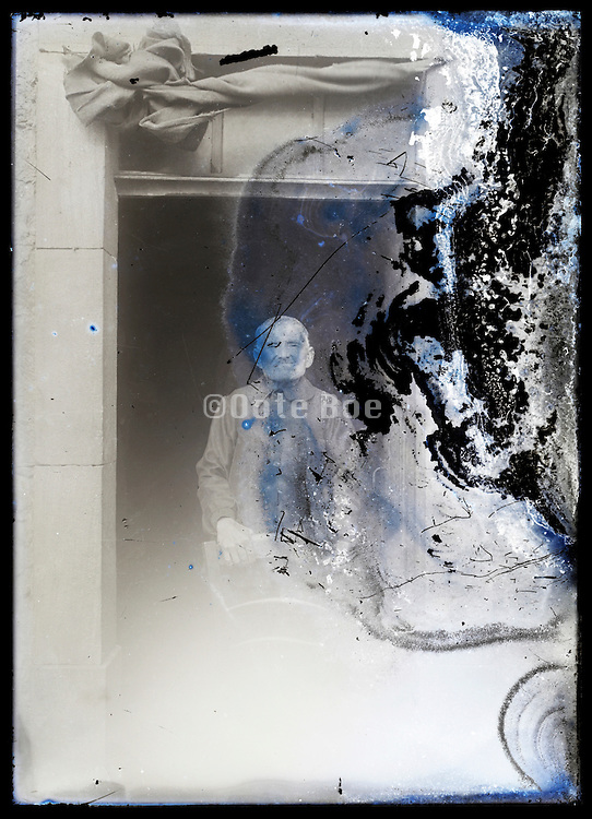 eroding glass plate photo of a senior man posing in the door opening