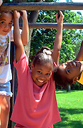 Friends age 9 playing in day camp at Minnehaha park.  Minneapolis  Minnesota USA
