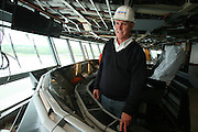 Oasis of the Seas at the shipyard in Turku, Finland where she is being built...Captain Bill Wright, Senior VP Marine Operations on the bridge of Oasis.