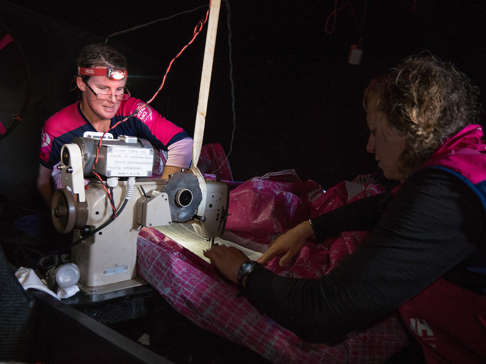 November, 2014. Leg 2 onboard Team SCA. Stacey Jackson and Annie Lush repair the J1 in the bow. The sail repair took 2hours 20 minutes and Team SCA lost no time on the rest of the fleet-- in fact, we actually gained on the guys despite not having the ideal sail up.