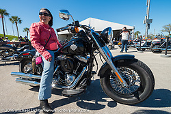 Deborah Speicher ready to head out on a test ride of a new Harley from the Harley-Davidson display during Daytona Bike Week, FL, USA. March 8, 2014.  Photography ©2014 Michael Lichter.