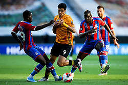 Raul Jimenez of Wolverhampton Wanderers takes on Tyrick Mitchell of Crystal Palace and Mamadou Sakho of Crystal Palace - Mandatory by-line: Robbie Stephenson/JMP - 20/07/2020 - FOOTBALL - Molineux - Wolverhampton, England - Wolverhampton Wanderers v Crystal Palace - Premier League