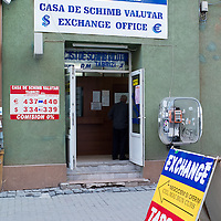 TIMISOARA, ROMANIA - APRIL 21:  A foreign Exchange shop is seen in the city centre on April 21, 2013 in Timisoara, Romania.  Romania has abandoned a target deadline of 2015 to switch to the single European currency and will now submit to the European Commission a programme on progress towards the adoption of the Euro, which for the first time will not have a target date. (Photo by Marco Secchi/Getty Images)