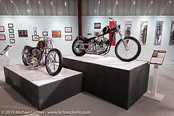 Michigan based builder Brandon Keene's Showtime 1976 Harley Davidson custom (L) and Majik Mike Designs' Mike Rabideau's Bloody Knuckle S&S Knucklehead on display in the What's the Skinny Exhibition (2019 iteration of the Motorcycles as Art annual series) at the Sturgis Buffalo Chip during the Sturgis Black Hills Motorcycle Rally. SD, USA. Friday, August 9, 2019. Photography ©2019 Michael Lichter.