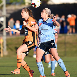 BRISBANE, AUSTRALIA - OCTOBER 30: Abbey Lloyd of the Roar and Alanna Kennedy of Sydney compete for the ball during the round 1 Westfield W-League match between the Brisbane Roar and Sydney FC at Spencer Park on November 5, 2016 in Brisbane, Australia. (Photo by Patrick Kearney/Brisbane Roar)