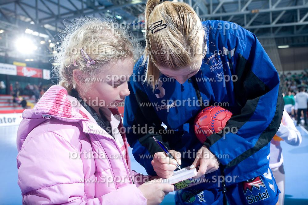 Spela Cerar signing autographs after EHF Champions league handball match in Group II between RK Krim Mercator and Gyori Audi Eto KC, on February 7, 2009, in Kodeljevo, Ljubljana, Slovenia. Gyori won 35:31. (Photo by Vid Ponikvar / Sportida)