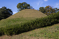 77.2 Takamatsuzuka Tumulus Burial Mound 高松塚壁画館 is a stone burial chamber containing a sarcophagus. The walls, ceiling and floor inside the stone chamber are decorated with murals painted on the walls and ceiling.  These murals were discovered here in 1972.  The tumulus itself is a special historic site and the four-colored murals are national treasures.  The discovery of the murals influenced Japanese archaeology, ancient history and art history.  Although the original murals are not normally available for public viewing, replicas are displayed in the Takarazuka Mural Hall next to the burial mound.