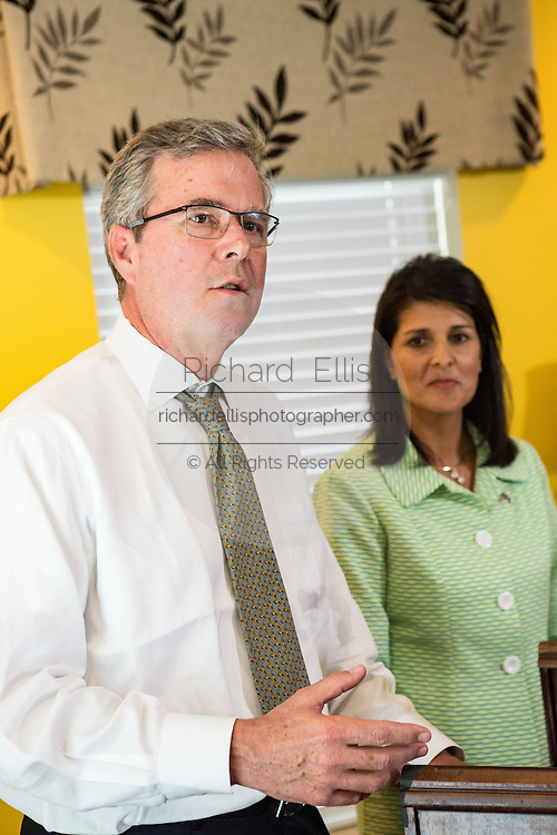 Former Florida Governor and GOP presidential candidate Jeb Bush and South Carolina Governor Nikki Haley speak to reporters with during a visit to Sistercare March 17 29, 2015 in Columbia, South Carolina. Bush joined Haley in visiting the center for victims of domestic violence.