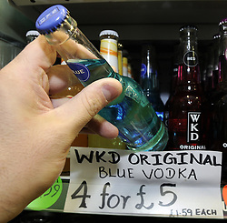 © Licensed to London News Pictures. 28/11/2012. Cheap alcohol being sold at a shop in Orpington, Kent on November 28, 2012. A minimum price of 45p for a unit will reduce the £42bn a year spent on alcoholic drinks in England and Wales by just over 3% but could curb crime and prevent 714 alcohol-related deaths each year, the Home Office has said. Photo credit : Grant Falvey/LNP