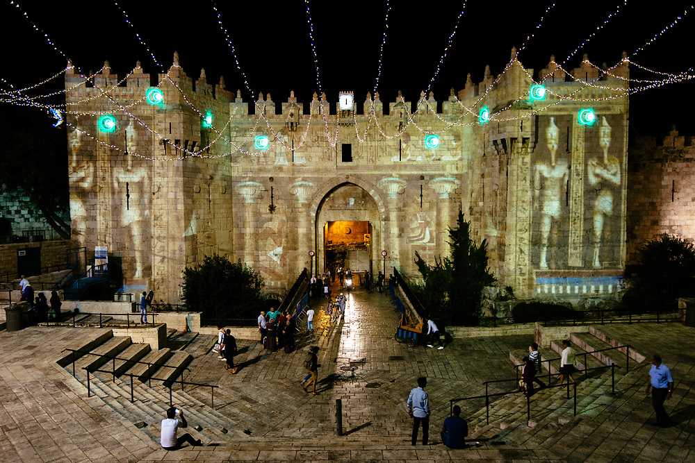 An audiovisual light show is projected over the walls of Damascus Gate, one of the entrances to the Old City of Jerusalem, during The Jerusalem Festival of light