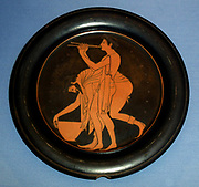 Plate designed by Epiktetos as painter.  Epiktetos was a pupil of the first painters to use the red-figure technique, invented in Athens in about 530 BC.  He decorated numerous cups and several plates.  His clarity of line and the delicacy of the two revellers enable us to recognise even his unsigned work.  Made in Athens about 520-500 BC