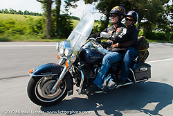 Stiffany and Calvin Taylor on a ride from Camp Lejeune Marine base in NC to Suck, Bang, Blow in Murrells Inlet in SC on the way to the Smokeout 2015. USA. June 17, 2015.  Photography ©2015 Michael Lichter.