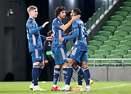 Eddie Nketiah of Arsenal celebrates the first goal with Ainsley Maitland-Niles, Mohamed Elneny and Emile SmithRowe during the Europa League Group B match between Dundalk and Arsenal at Aviva Stadium, Dublin, Republic of Ireland on 10 December 2020.