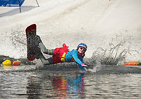 "Emma Fortin's ""super powers"" came up a wee bit short during her pond crossing attempt at Gunstock's annual end of the season B.Y.O.D.C. event on Sunday afternoon.  (Karen Bobotas/for the Laconia Daily Sun)"