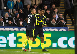 SWANSEA, WALES - Saturday, January 14, 2017: Arsenal's Alex Iwobi celebrates his goal against Swansea City with Aaron Ramsey during the FA Premier League match at the Liberty Stadium. (Pic by Gwenno Davies/Propaganda)
