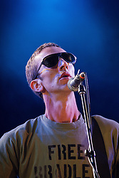 """© Licensed to London News Pictures . 20/07/2013 . Suffolk , UK . Richard Ashcroft performs on the 6music stage wearing a """" Free Bradley Manning """" t-shirt . The Latitude music and culture festival in Henham Park , Southwold . Photo credit : Joel Goodman/LNP"""