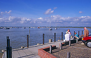 AYBPD5 Two retired couples chatting at Bawdsey Quay River Deben Suffolk England