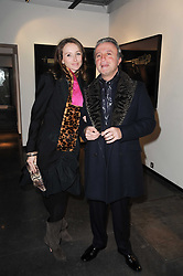 RAFI & JO MANOUKIAN at a private view of photographs by Guido Mocafico entitled 'Guns and Roses' held at Hamiltons Gallery, 13 Carlos Place, London W1 on 21st January 2010.