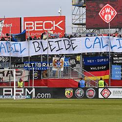 """Die Fans mit einem Plakat """"Stabil bleibe Calli!!!"""" beim Spiel in der 3. Liga, FC Wuerzburger Kickers - SV Waldhof Mannheim.<br /> <br /> Foto © PIX-Sportfotos *** Foto ist honorarpflichtig! *** Auf Anfrage in hoeherer Qualitaet/Aufloesung. Belegexemplar erbeten. Veroeffentlichung ausschliesslich fuer journalistisch-publizistische Zwecke. For editorial use only. DFL regulations prohibit any use of photographs as image sequences and/or quasi-video."""
