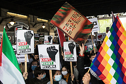 London, UK. 22nd May, 2021. Activists from an International Bloc highlighting current human rights abuses in Palestine, Israel, Colombia and Tigray join tens of thousands of people on the National Demonstration for Palestine. It was organised by pro-Palestinian solidarity groups in protest against Israel's recent attacks on Gaza, its incursions at the Al-Aqsa mosque and its attempts to forcibly displace Palestinian families from the Sheikh Jarrah neighbourhood of East Jerusalem.