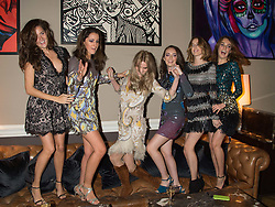 Left to right, ROSE THOMAS, ROSANNA FALCONER, GEORGIE MACINTYRE, LADY ELIZA MANNERS, LADY ALICE MANNERS and LADY VIOLET MANNERS at the Tatler Little Black Book Party at Home House Member's Club, Portman Square, London supported by CARAT on 11th November 2015.