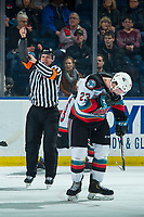 KELOWNA, BC - JANUARY 24: Referee Nick Panter makes a high sticking call against the Seattle Thunderbirds on Jake Poole #23 of the Kelowna Rockets at Prospera Place on January 24, 2020 in Kelowna, Canada. (Photo by Marissa Baecker/Shoot the Breeze)