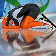 Winter Olympic Games Vancouver, British Columbia.Speedskater Annette Gerritsen representing Holland languishes after crashing into a wall during the first of two heats of the women's 500m race at the 2010 Winter Olympic Games in Vancouver, British Columbia. Gerristen went on to win the Silver Medal in the 1000m 2 hundredths of secon behind gold medalist Christine Nexbitt of Canada.