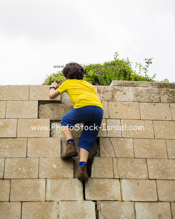 Young boy of ten climbs on a wall.<br /> Humpty Dumpty sat on a wall,<br /> Humpty Dumpty had a great fall<br /> All the king's horses and all the king's men<br /> Couldn't put Humpty together again.