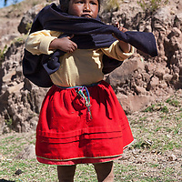 A little girl posing near her house on Taquile Island.
