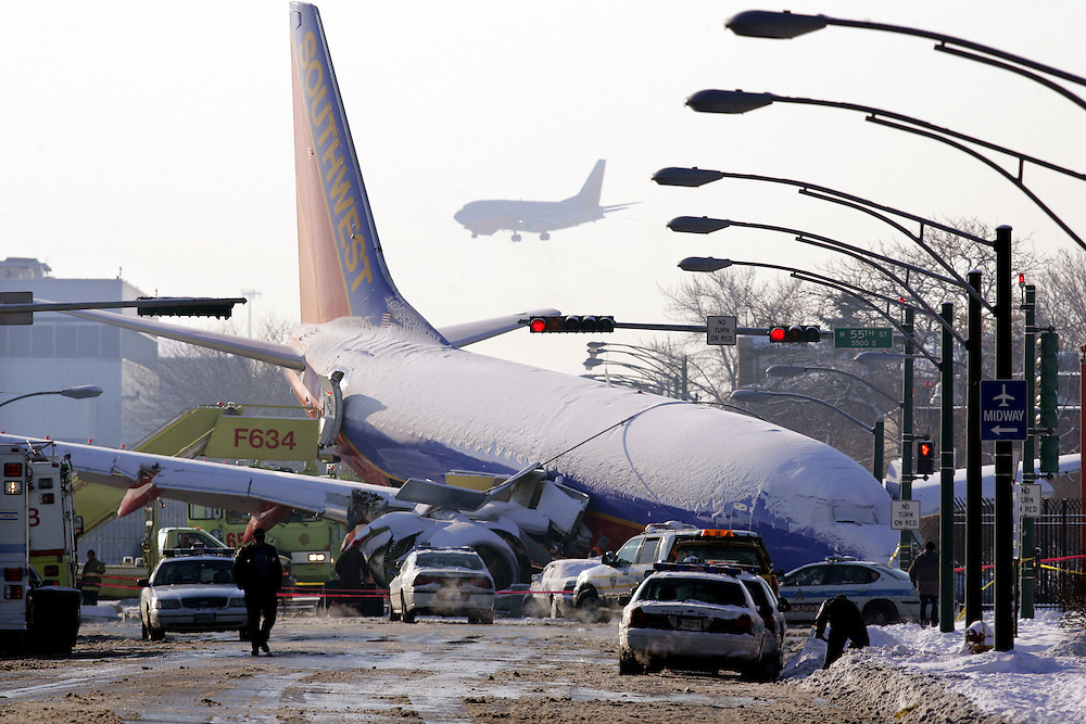 A Southwest Airlines 737 sits in the intersection of Central Ave and 55th Streets just outside Chicago's Midway Airport Friday morning.  The plane, a flight  was landing from Baltimore, skidded off the runway during a snowstorm, colliding with at least one car. A six-year-old boy from Indiana, was killed in the car and several others were injured.  Midway airport received nearly ten inches of snow in a ten hour period Thursday.