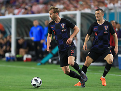 March 23, 2018 - Miami Gardens, Florida, USA - Croatia defender Ivan Strinic (3) moves the ball followed by Croatia midfielder Ivan Perisic (4) during a FIFA World Cup 2018 preparation match between the Peru National Soccer Team and the Croatia National Soccer Team at the Hard Rock Stadium in Miami Gardens, Florida. (Credit Image: © Mario Houben via ZUMA Wire)
