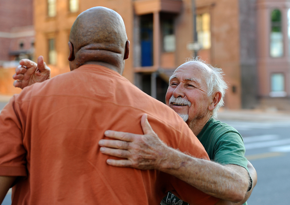 Danny Thomas hugs from Anthony Cymerys, known as Joe the barber, after his haircut in Hartford, Conn.