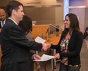 Houston ISD highly effectve teachers are recognized by Dr. Andrew Houlihan, left, and Trustee Rhonda Skillern-Jones during a principal meeting, March 5, 2014.