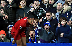Liverpool's Virgil van Dijk in front of the Everton fans during the Premier League match at Goodison Park, Liverpool.