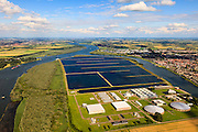 Nederland, Zuid-Holland, Gemeente Spijkenisse, 15-07-2012; Beerenplaat met productielocatie voor drinkwater Berenplaat van drinkwaterbedrijf Evides aan de Oude Maas..Production location for drinking water Berenplaat of drinking water company Evides. .luchtfoto (toeslag), aerial photo (additional fee required).foto/photo Siebe Swart
