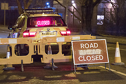 © Licensed to London News Pictures . 02/12/2012 . Bury , UK . Bury Road is closed to traffic as police investigate . Scene of a fatal road traffic accident on Bury Road , Radcliffe . Police report a car , a silver VW Polo , overturned and collided with a tree after it was observed driving at excess speed along Bury Road . A police car with its emergency equipment activated was in pursuit at the time . The driver and a passenger died at the scene . The road is closed . Photo credit : Joel Goodman/LNP