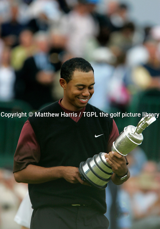 Tiger WOODS (USA) with the famous claret jug trophy during fourth round The Open Championship 2005,St Andrews Old Course,St Andrews,Fife,Scotland.