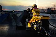 Tommy Bolton helping Glen Nickleberry launch down drag strip at Thunder Valley Raceway in Noble, Oklahoma