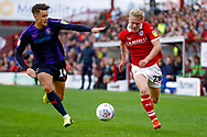 Luton Town forward Harry Cornick (14) races with Barnsley defender Ben Williams (28)  during the EFL Sky Bet League 1 match between Barnsley and Luton Town at Oakwell, Barnsley, England on 13 October 2018.