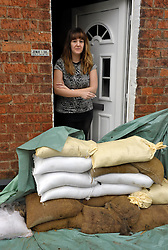 © Licensed to London News Pictures. 14/02/2014; Gloucester, UK.  Charlie Burgess in Alney Terrace in Alney Island which is subject to a Severe Flood Warning, threatened by rising water levels from the nearby river Severn.  The residents have been given sandbags by Gloucestershire Council.<br /> Photo credit: Simon Chapman/LNP