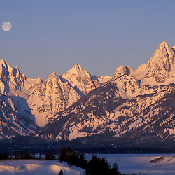 Snake River Overlook, Grand Teton N.P...A full moon sets behind the Tetons. Snake River.