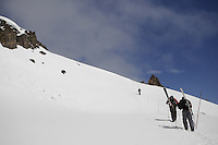 Skiers hike Pepi's Bench to the top of the Headwall during the Coombs Classic at Jackson Hole Mountain Resort