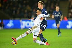 Martin Olsson of Swansea City tackles Christian Eriksen of Tottenham Hotspur - Mandatory by-line: Alex James/JMP - 02/01/2018 - FOOTBALL - Liberty Stadium - Swansea, England - Swansea City v Tottenham Hotspur - Premier League