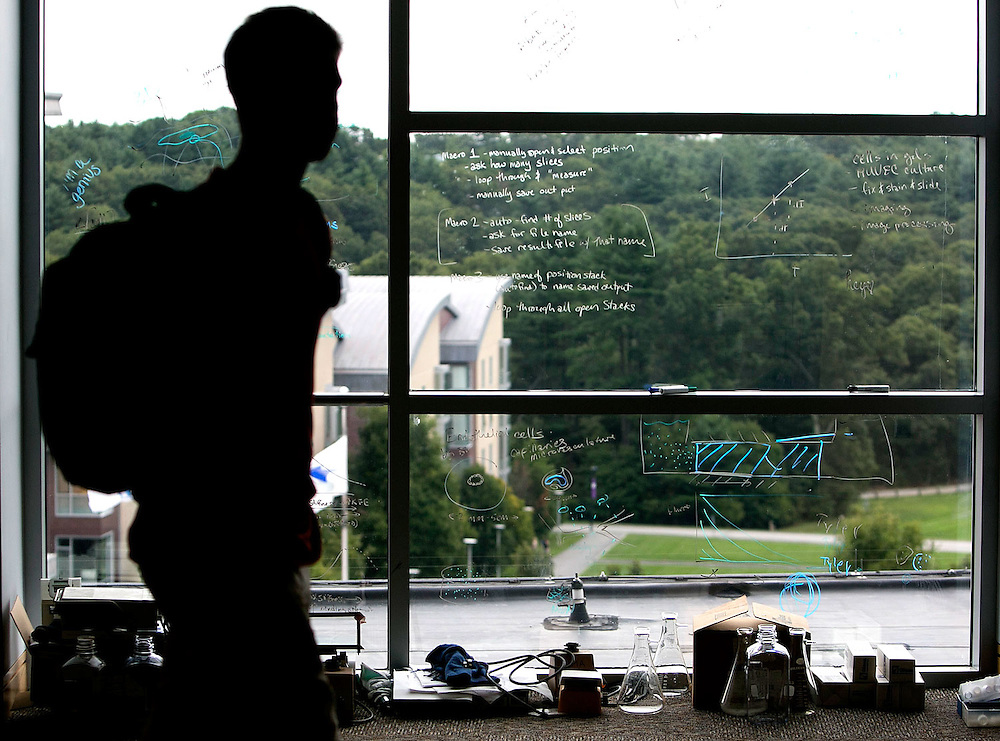 09/05/2013 -- NEEDHAM, Mass. -- A student walks past a window that was used as a whiteboard at Olin College on Sept. 5, 2013. (Kelvin Ma for the Chronicle of Higher Education)