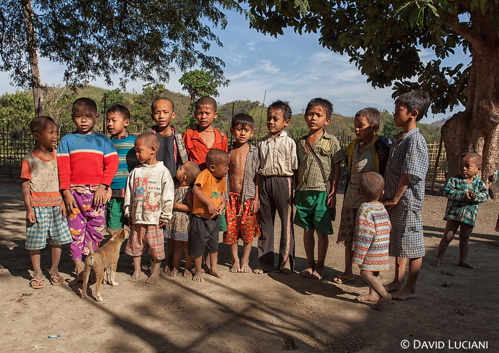 Kids posing at the main place of a Chin village situated near Lemro River.
